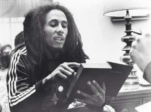 Bob Marley reading the bible
