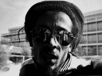 Bob Marley string at the sun through sunglasses