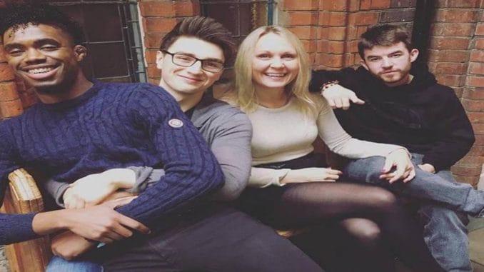 Dalton Harris sitting in the lap of fellow X Factor contestant Brendan Murray