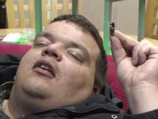 Fat person smoking marijuana