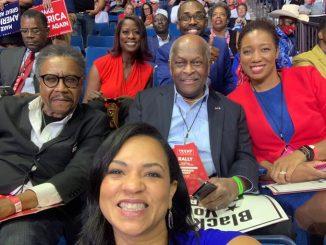 Herman Cain at Donald Trump rally